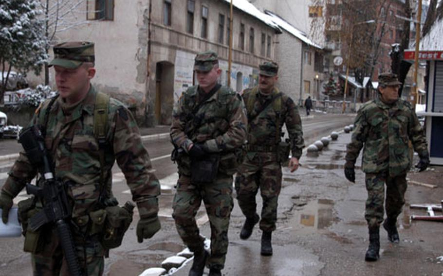 Staff Sgt. Matthew Stockhouse, left, Sgt. Jon Clay, Spc. Kevin Bubb, all of Company C, 1st Battalion, 109th Infantry Regiment, and their interpreter, Ivanovic, patrol the sleepy town of Zvornik in eastern Bosnia and Herzegovina on New Year's Day.