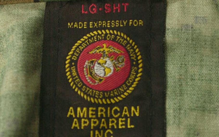 """Officials are urging Marines to check the label for one of the tell-tale tags that states the new uniform is """"expressly made for"""" Marines."""