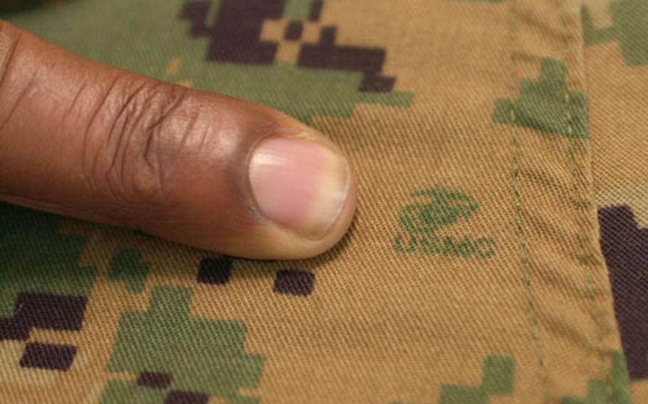 Officals are uging Marines to look for the tiny Eagle, Globe and Anchor printed in the middle of the digital patterns to verify the uniforms are authentic and authorized for wear.