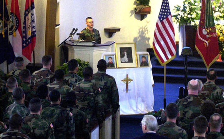 In this photo from November 2000, the Leighton Barracks chapel in Würzburg was full for the memorial ceremony for the Goodridge family. Maj. Michael Goodridge, his wife, Jennifer, and their sons, Michael and Kyle, died in a cable-car tunnel fire in Austria on November 11.