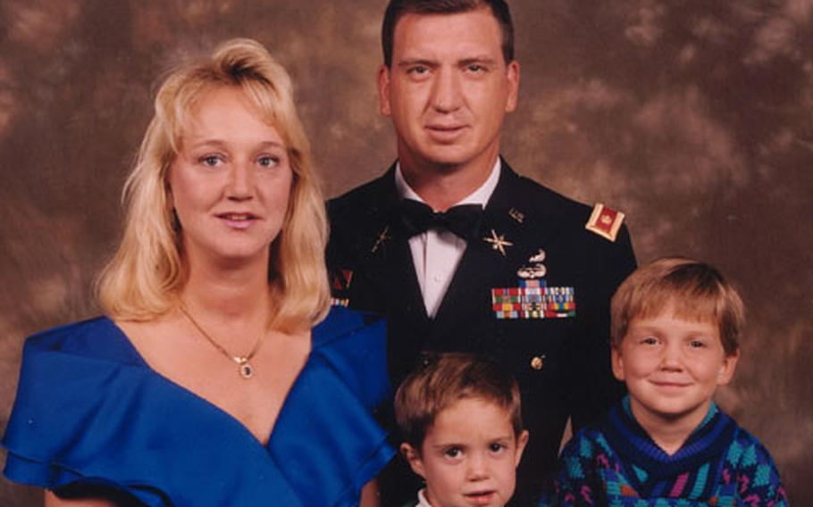The last family portrait of Army Maj. Michael Goodridge, his wife, Jennifer, and their sons, Kyle, left, and Michael. The family was killed Nov. 11, 2000, when a ski cable car caught fire inside a tunnel at an Austrian ski resort.