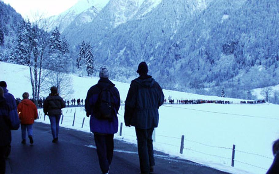 Hundreds of people who lost friends and family in the fire are shown walking six miles from Kaprun, Austria, to the resort where the accident happened for a memorial service one year later in November 2001.