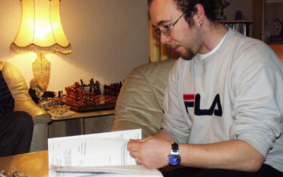Alexander Hofmann thumbs through a scrapbooks of newspaper clippings and documents about his near-fatal stabbing last June while driving a taxi in Schweinfurt, Germany. The only suspect is an American soldier stationed at Schweinfurt's Conn Barracks, but Hofmann and his family are afraid the soldier is about to be discharged and sent home without a trial.