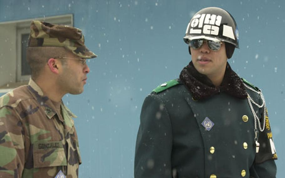 A South Korean and U.S. soldier brave the snow during guard duty at Panmunjom on Friday.