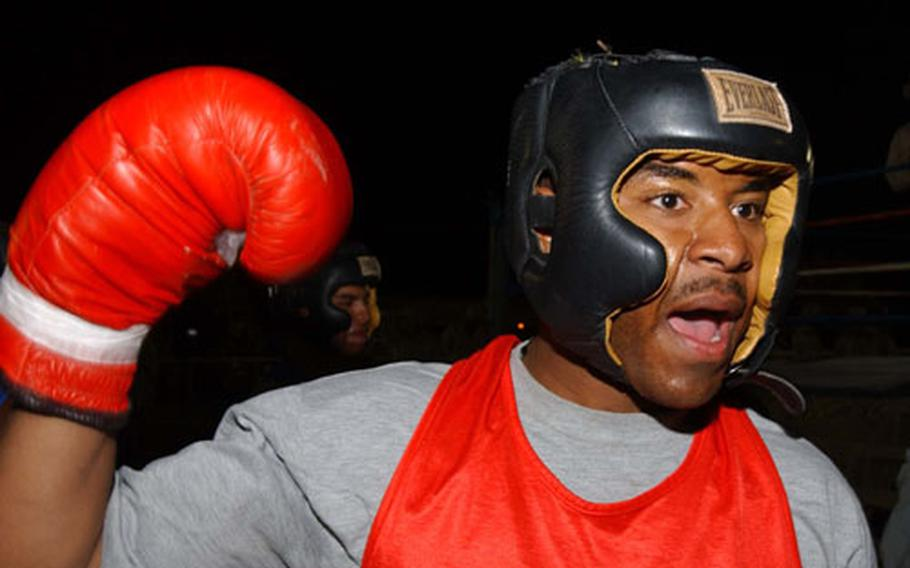 Staff Sgt. Laney Robinson, of the 3rd Infantry Division's 2nd Brigade Combat Team, prepares to enter the ring.