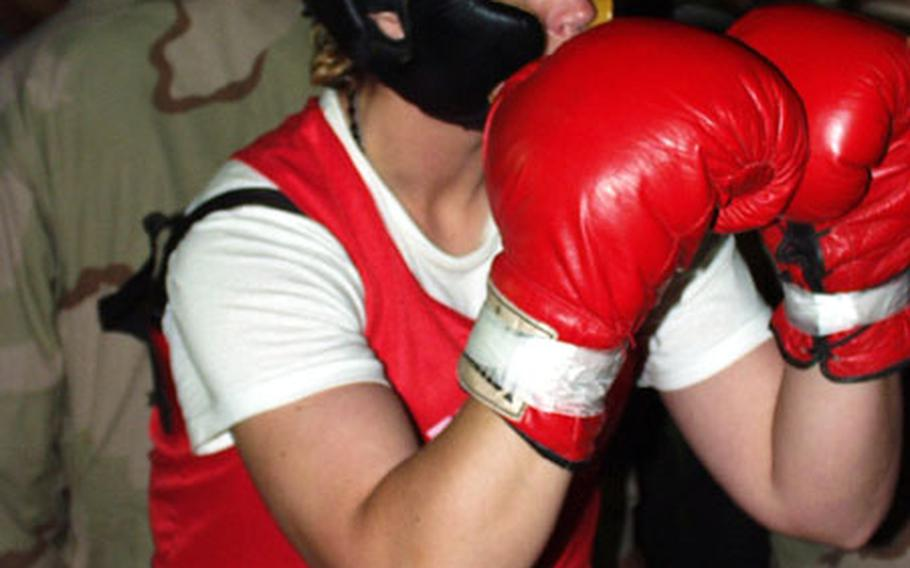 Sgt. Jessica Dull warms up for a boxing match Saturday at Camp New York, Kuwait.