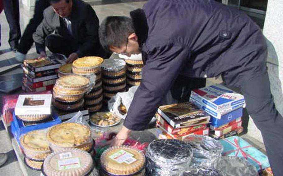 Officers of Korean National Police assigned to Nam-bu station in Taegu, South Korea, sort just some of the 136 pies and other baked goods dropped off at their headquarters by the U.S. Army to thank the cops for round-the-clock guard duty they pull outside three installations in Taegu, Camps Henry, Walker, and George.