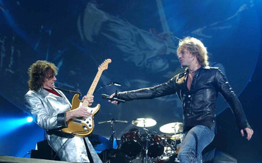 Jon Bon Jovi and Richie Sambora rock out at the Sapporo Dome Thursday. The band gave 100 free tickets to U.S. soldiers training in the area.
