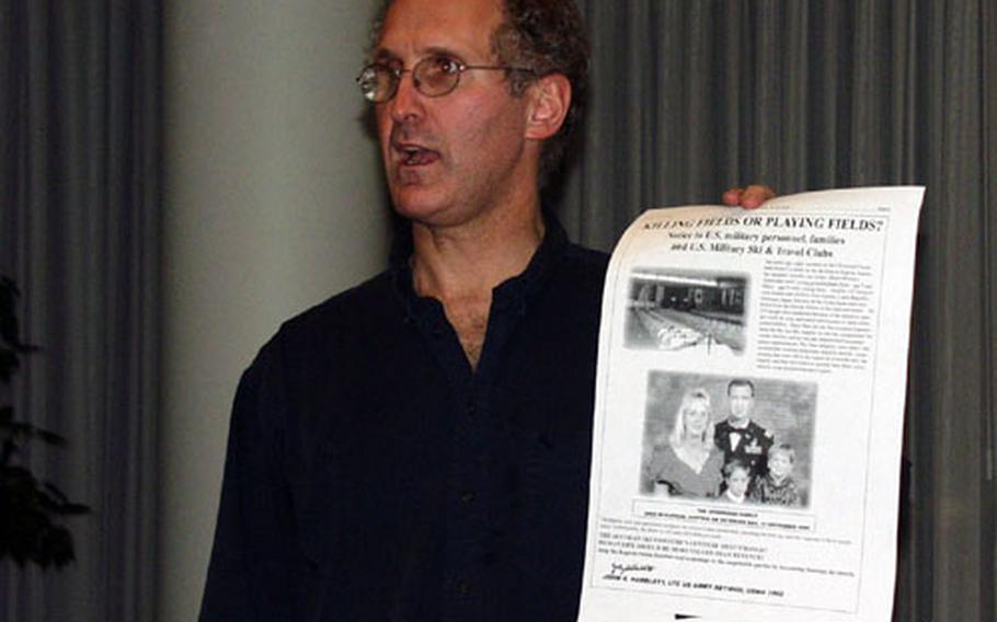 Ed Fagan, an American attorney who has filed a class-action lawsuit on behalf of the families of the victims of the Kaprun ski train disaster, holds up a copy of an advertisement that appeared in the Stars and Stripes, while speaking to Austrians who lost loved ones in the tunnel fire. Fagan said similar advertisements have appeared in a Slovenian newspaper and that a German ski magazine would join the ranks soon.