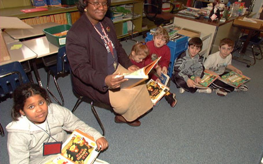 Patricia Wilson's second and third grade class participates in story time on Friday. The four remaining teachers at the school have taken on multiple grades in their classrooms until the students all relocate to Vilseck and Hohenfels on Jan. 27.