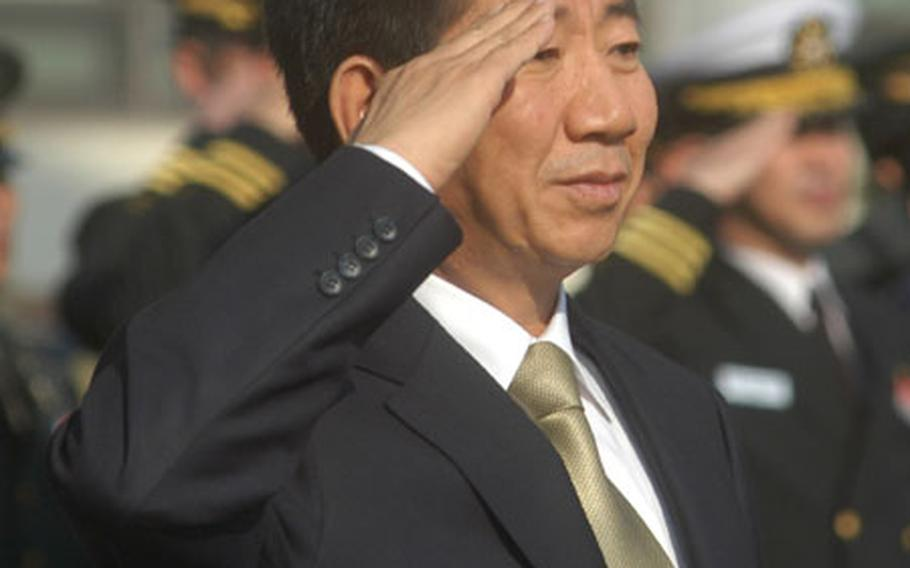 South Korean President-elect Roh Moo-hyun salutes during a ceremony Wednesday at Yongsan Garrison, South Korea.