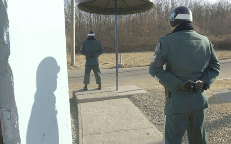 Republic of Korea (ROK) Army soldiers guard the road leading to Tae Sung Freedom Village, located on the southern side of the Demilitarized Zone.