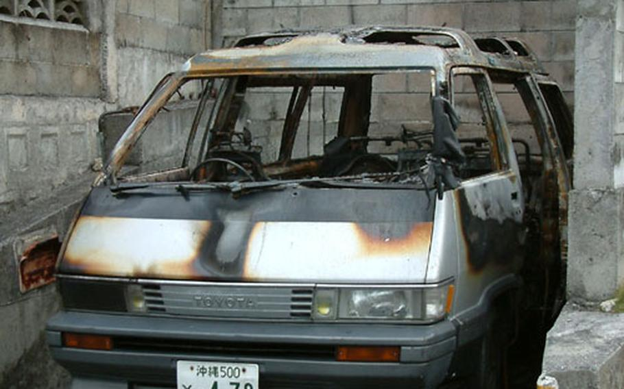 Okinawa police suspect an arsonist set the fire that gutted this van, owned by a Marine, in Chatan early Tuesday.