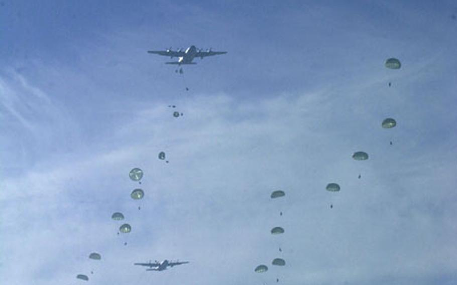 Three C-130s drop soldiers of the 2nd Bn, 503rd Infantry Regiment (Airborne) near Klina, Kosovo, on Jan. 15. The drop began the month-long Operation Rapid Guardian 03-1 exercise, signifying NATO's ability and will to protect the people of Kosovo.