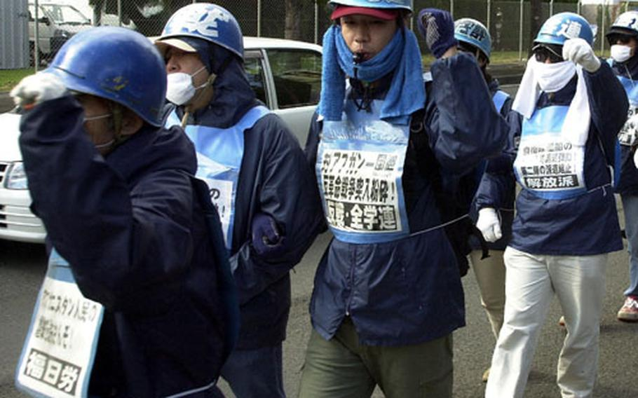 U.S. military action in the war on terror, expected to draw protestors this weekend, also has drawn protests in the past. Above, about 100 protesters marched near Sasebo Naval Base in November 2001, protesting Japanese participation in the war on terrorism in Afghanistan. Protests are expected throughout Japan this weekend as part of international demonstrations against any possible U.S. war against Iraq.