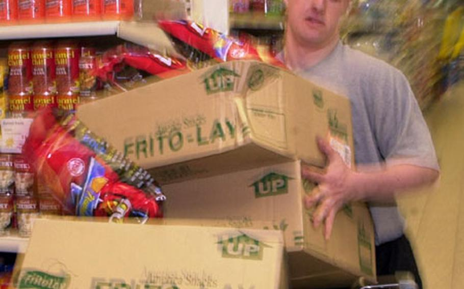 Spc. Justin Brown found out it's hard work filling 30 grocery carts in five minutes. Brown got a five-minute shopping blitz Friday morning at Baumholder's commissary, part of his being selected U.S. Army Soldier of the Year.