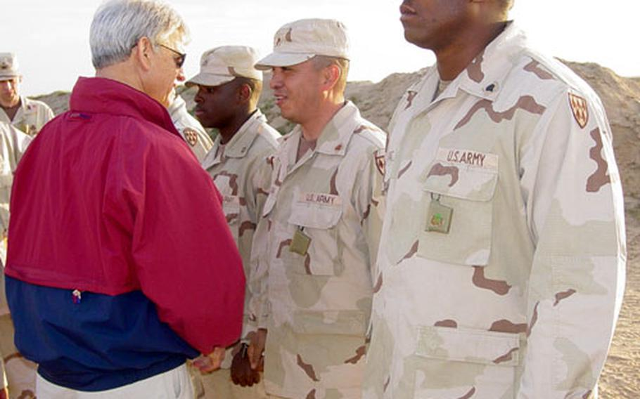 U.S. Undersecretary of the Army Les Brownlee meets with soldiers Thursday at a Patriot missile battery at Al Jaber Air Base, Kuwait.