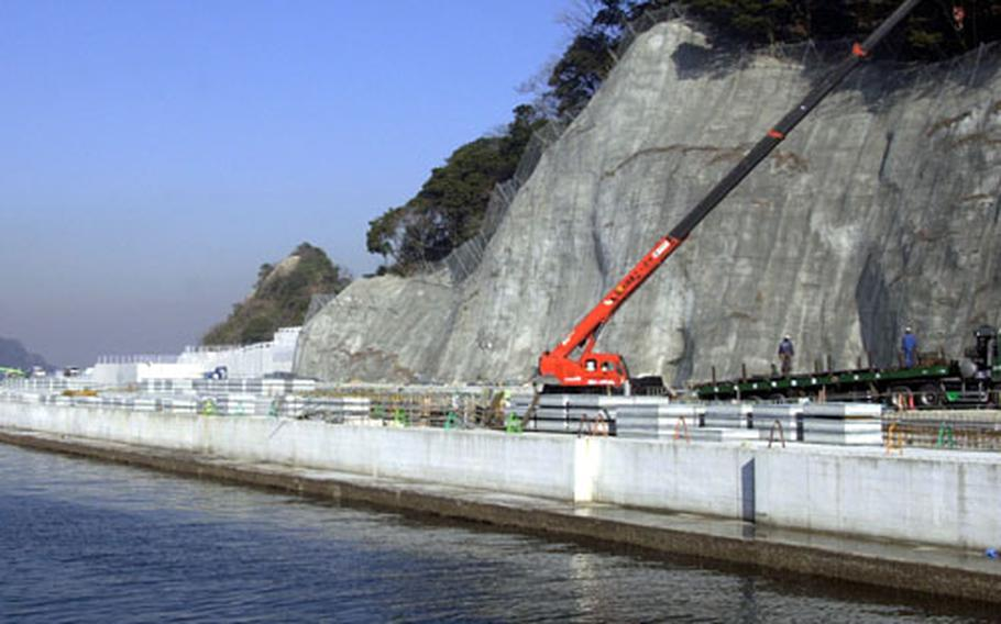 Construction on the Piedmont Pier, or Pier 12, is about to begin again after Yokosuka City officials approve an environmental plan for the project.