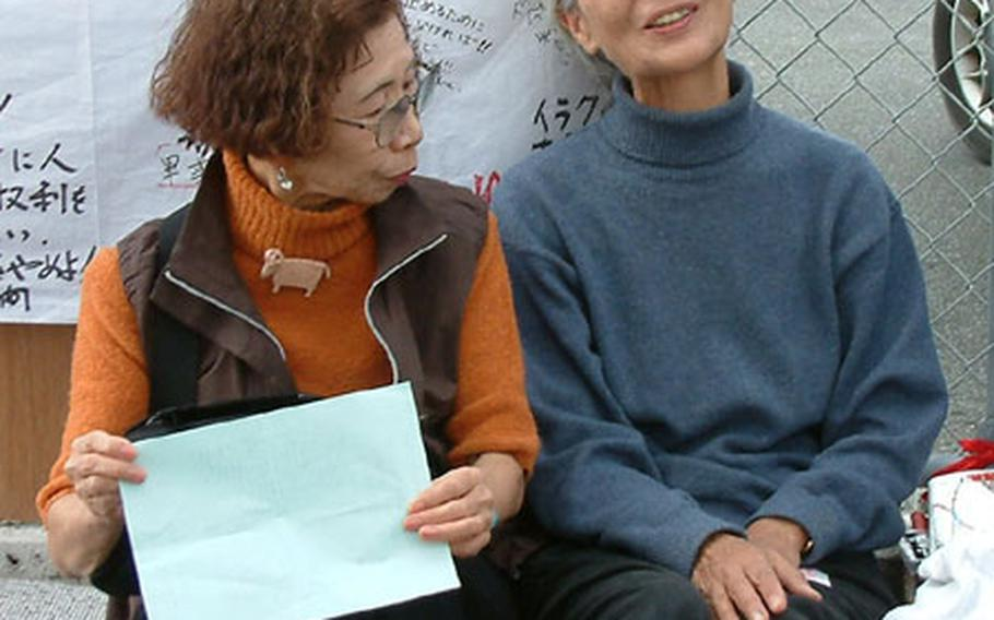 Etsumi Tairahori, 69, right, is on a hunger strike and nine-day sit-in at the U.S. Consulate in Urasoe to protest the looming war in Iraq. Joining her is Yoko Kitajima, a tourist from Nagoya.