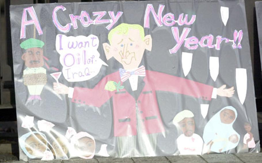 Some of the signs showed diapproval for President Bush at an anti-war protest in central Tokyo on Saturday.