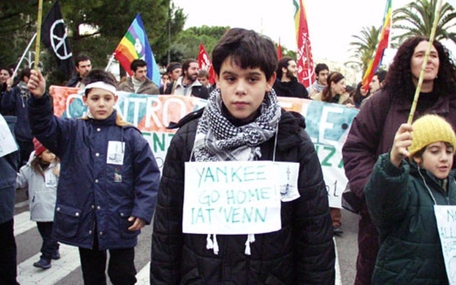 Silvio Paone, 12, was one of about 250 anti-war demonstrators marching through Gaeta, Italy, on Saturday.