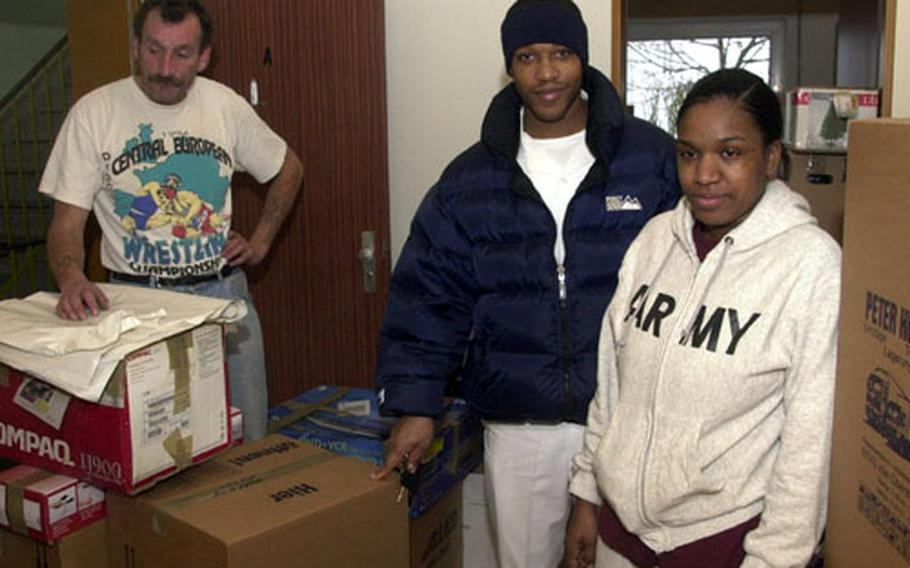 As a German mover packs up their household goods in December, Spc. Paqueshia Williamson and her husband, Sean Williamson, right, hope that quarters with better ventilation will end the family's year-long battle with mold. The Williamsons got an exception to policy after Baumholder officials declared their quarters unfit for habitation.