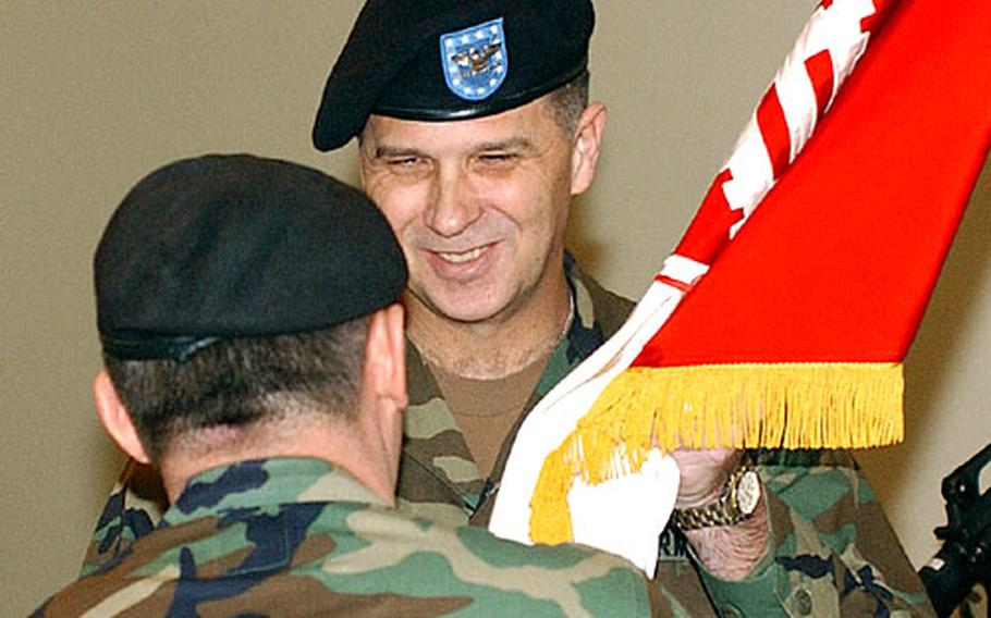 Col. William H. McCoy, facing the camera, receives the just-unfurled colors of the 18th Engineer Brigade from Maj. Gen. Anthony R. Jones, USAREUR chief of staff. McCoy is the brigade's commander. The brigade will be headquartered at Campbell Barracks in Germany.