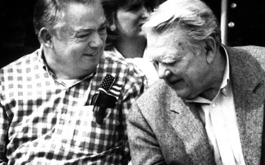 Stripes alumni Bill Mauldin, left, and commentator/columnist Andy Rooney share a joke during the paper's 50th anniversary celebration in Germany in 1992.