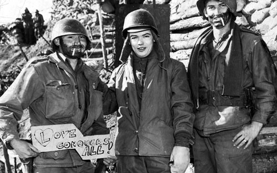 "Bill Mauldin, center, meets ""Willie and Joe"" on Heartbreak Ridge in Korea in 1952. Left is Pfc. John (""Willie"") Owens; at right is Pvt. Lawerence (""Joe"") Reid."