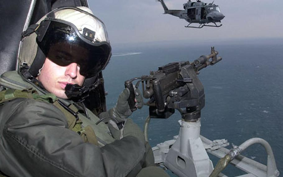Marine Cpl. Paul O'Brien awaits arrival at the target while in a formation flight off the coast of Okinawa.