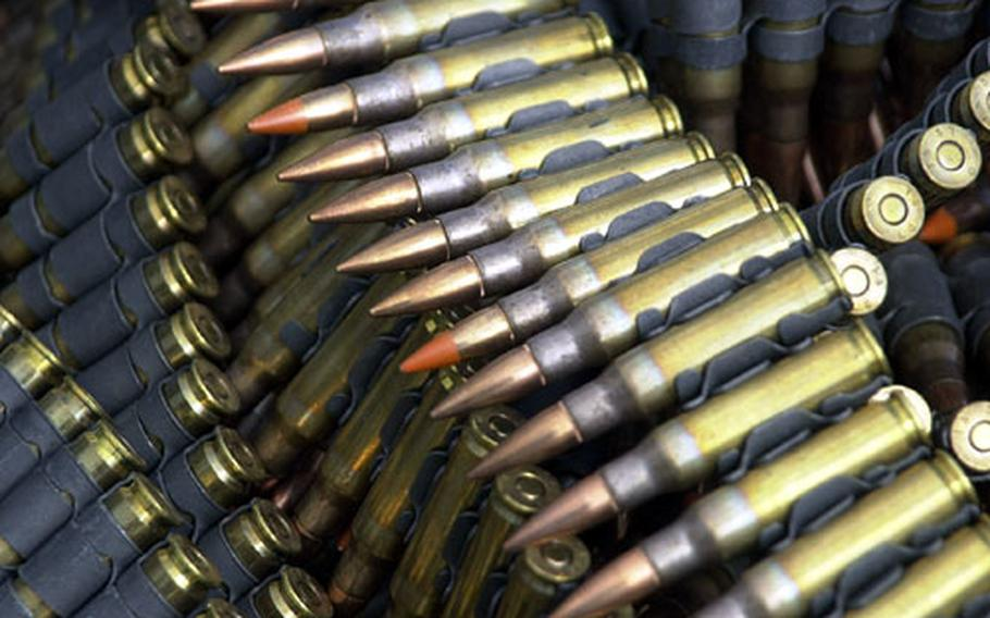 Belted 7.62mm rounds dumped in a heap prior to being loaded in the M-240G machine guns mounted on the doors of a UH-1N Huey.
