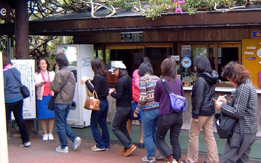Tourists from mainland Japan file into Okinawa's Southeast Botanical Gardens Thursday. Last year was a record year for tourism on Okinawa.