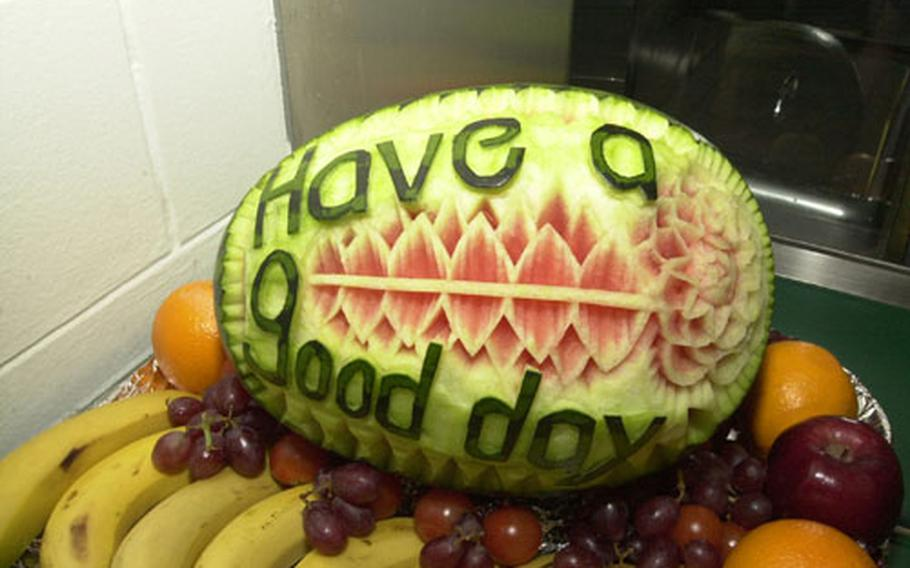 A message carved into a watermelon greets patrons of the Camp Jackson Dining Facility.