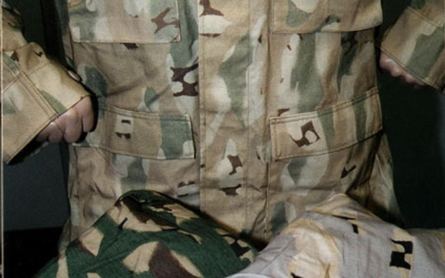 """The """"track"""" camouflage pattern being tested by researchers at the U.S. Army's Soldier Systems Center in Natick, Mass. This is the same laboratory that researched and designed the Marines' digital-patterned uniform distinct to the Corps. Goal: Help conceal soldiers better than the current woodland pattern, fielded in 1981."""