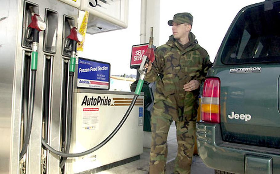 """Rising gas prices """"might slow down the travel"""" around Germany in the family's Jeep SUV, said Sgt. Scott Crum of Headquarters, Headquarters Co., 40th Engineering Battalion, as he gassed up Tuesday."""