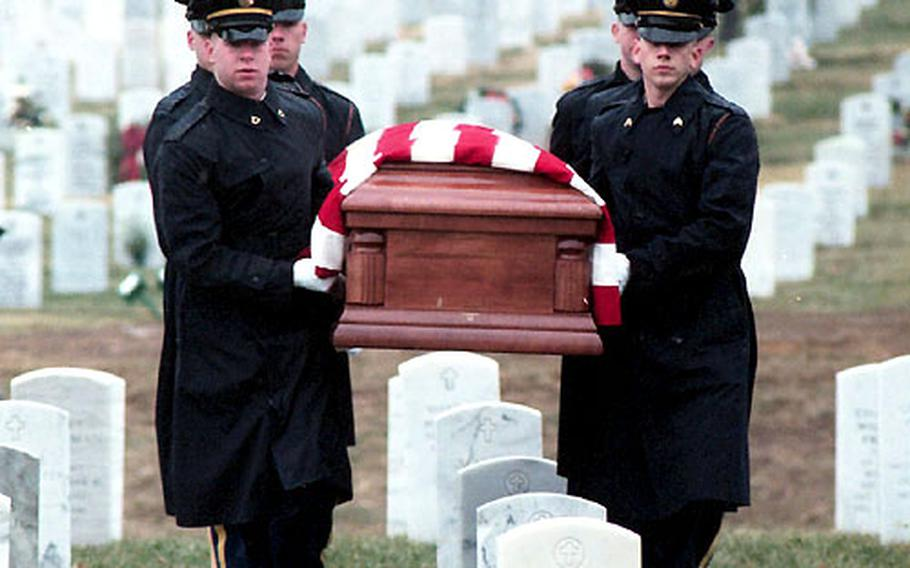 An honor guard from the Army's 3rd U.S. Infantry Regiment carries Bill Mauldin's casket to his grave Wednesday at Arlington National Cemetery.