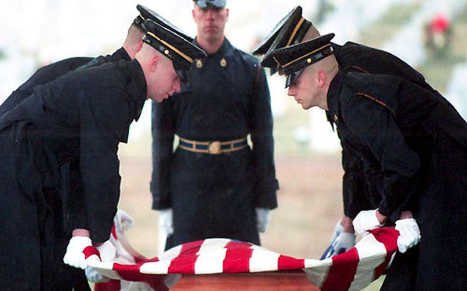 The casket team folds the flag for presentation to Bill Mauldin's family.