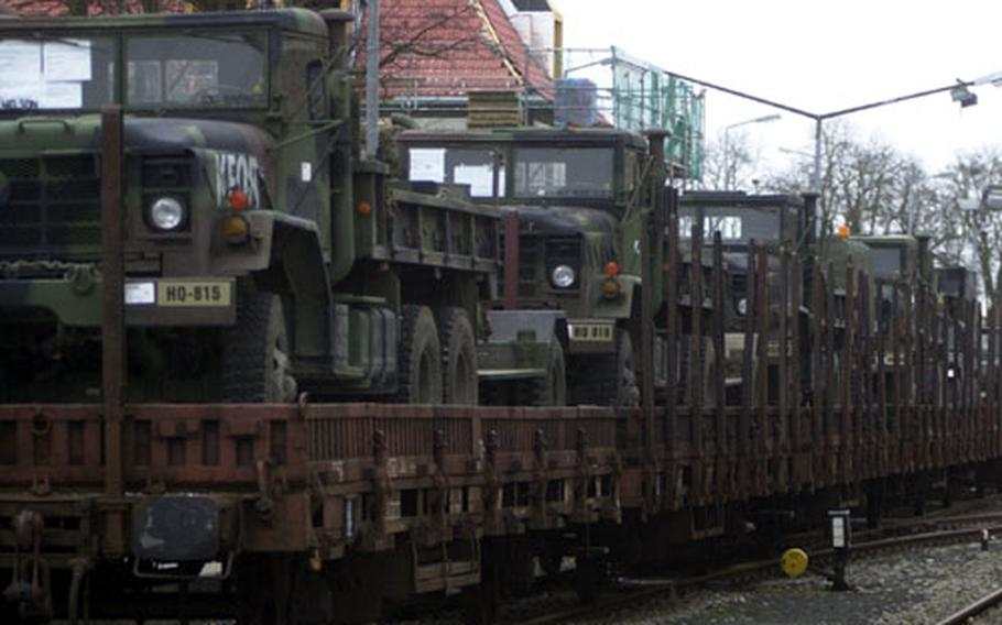 1st Infantry Division soldiers load rail cars with gear and equipment bound for Turkey on Friday.