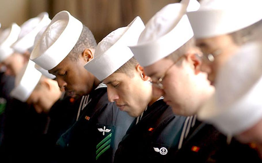 NAF Atsugi sailors bow their heads during the memorial service for Lt. Nathan D. White.