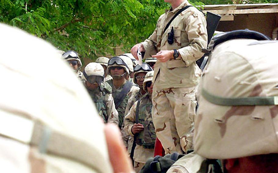 Army Lt. Col. Hank Dodge, V Corp commander of the Special Troops Battalion, tells soldiers who arrived at Victory Camp what they should expect in terms of living conditions.