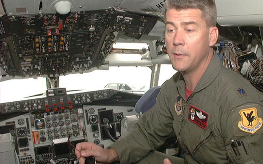 Inside a KC-135 cockpit, Lt. Col. Kyle Garland explains how avionics upgrades provide greater safety for pilots.