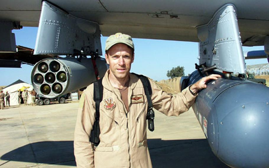 Lt. Col. Steve Chappel, commander of the 303rd Fighter Squadron, points out the targeting pod on an A-10 aircraft Wednesday. It allows pilots to monitor and record movement on the ground from as high as four miles, while relaying the information about enemies to U.S. ground troops.