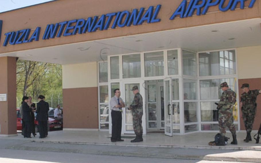 The Tuzla International Airport reopened Wednesday after being shut down following the Sept. 11 terrorist attack in the United States for security reasons. Stabilization Force representatives, local officials and the airport management cooperated on improving the security conditions to reopen the airport which shares the flight line with SFOR Eagle Base. (enw# 70p sb)