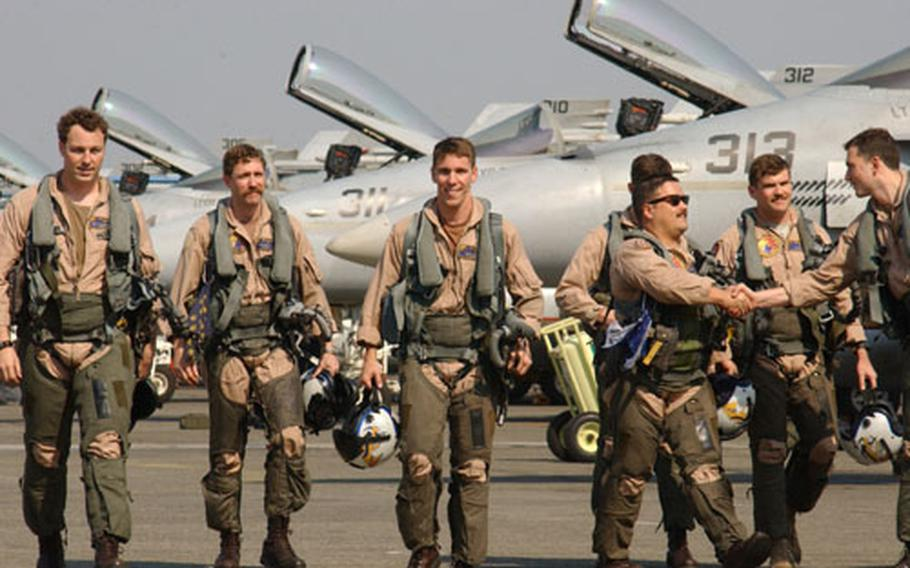Pilots from Strike Fighter Squadron One Nine Two, step off their planes and onto some steady ground. After a long deployment on board the aircraft carrier USS Kitty Hawk, family and friends are happy to have their heroes back.