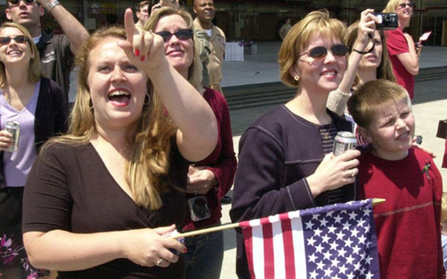 Wives and family of the pilots from Fighter Squadron 195 rejoice when they see F/A-18 jets fly over Atsugi Naval Air Facilty. The squadron was deployed for several months in support of Operation Iraqi Freedom.