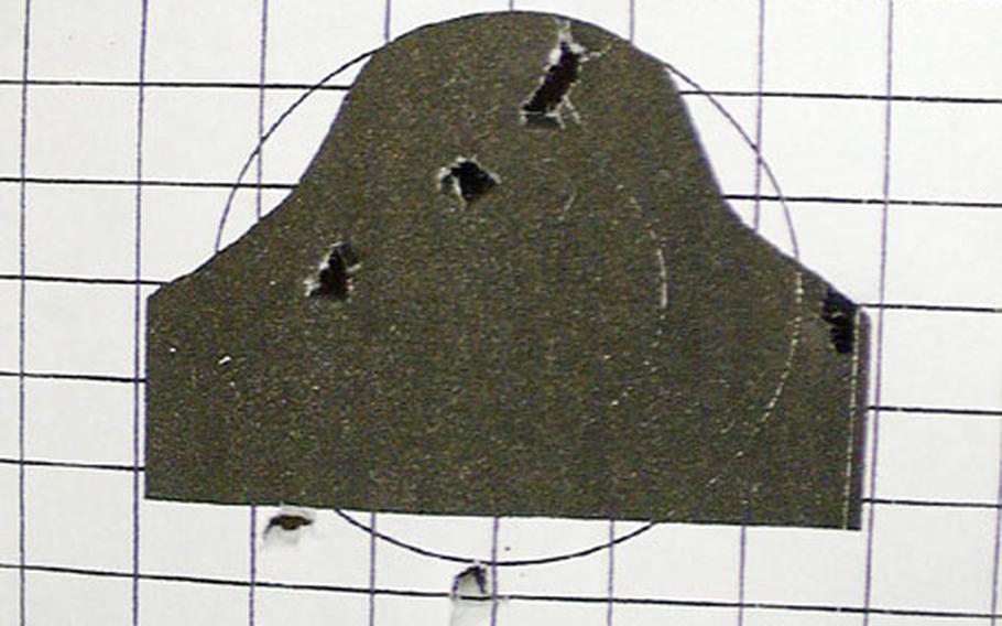 Shot-holes pockmark a target after a strong of fire a Kubasaki High School's Marine JROTC air pistol qualification on Okinawa.
