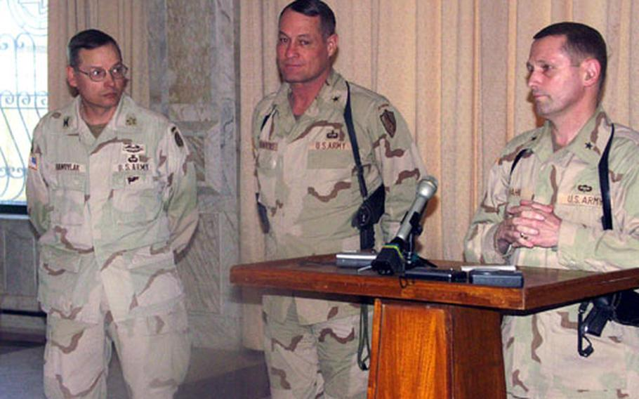 From left, Army Col. Mike Hawrylak, Coalition Forces Land Component Command deputy operations officer, Army Brig. Gen. Steven Hawkins, commander of Task Force Fajr, and Army Brig. Gen. Daniel Hahn, V Corp chief of staff, discuss recent operations in Iraq on Thursday. They were in the presidential palace on Victory Camp in Baghdad.