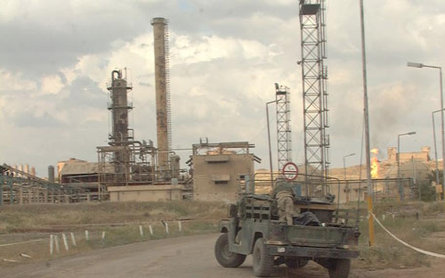 A large oil facility just north of Kirkuk is under the watchful eyes of soldiers assigned to Delta Battery, 319th Field Artillery, 173rd Airborne Brigade. The artillery unit moved in shortly after the area fell to coalition forces in mid-April. Soldiers patrol the facility on foot as well as by Humvee.