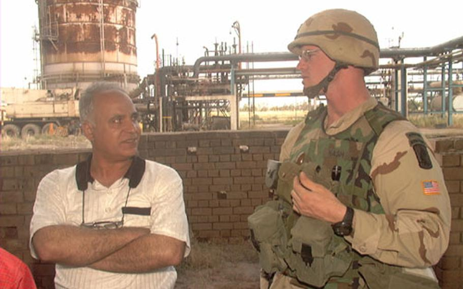 The Kirkuk facility also produces natural gas, according to Hassan Shunasi, the facility's shift control operator. Pictured with Shunasi is U.S. Army 1st Lt. Brian Nash, 25, of East Grand Rapids, Mich. Nash is the executive officer for Delta Battery, 319th Field Artillery, 173rd Airborne Brigade.