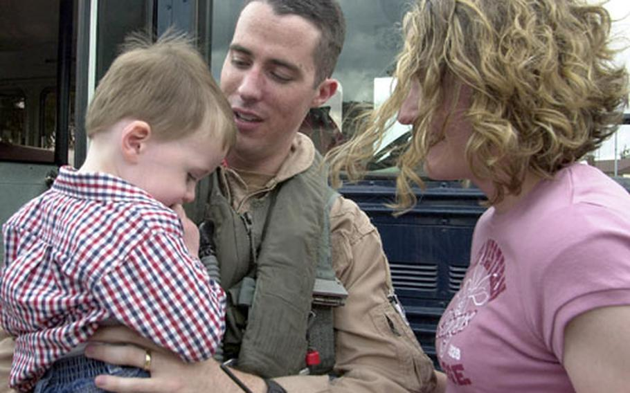 Connor O'Malley, 2, looks a little shy as he and his mom, Samantha, welcome dad, Capt. Derek O'Malley back to Spangdahlem Air Base, Germany.